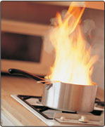 A stovetop pot engulfed in flames